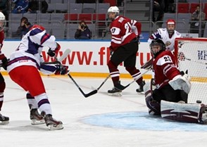 SOCHI, RUSSIA - APRIL 22: Latvia's Kristaps Nazarovs #29 looks to make the save during preliminary round action against Russia at the 2013 IIHF Ice Hockey U18 World Championship. (Photo by Francois Laplante/HHOF-IIHF Images)