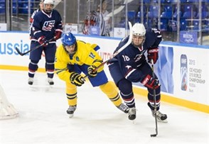 SOCHI, RUSSIA - APRIL 25: USA's Steven Santini #16 stickhandles the puck while being pursued by Sweden's Andre Burakowsky #12 during quarterfinal action 2013 IIHF Ice Hockey U18 World Championship. (Photo by Matthew Murnaghan/HHOF-IIHF Images)
