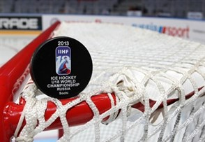 SOCHI, RUSSIA - APRIL 26: The Offiicial Game Puck of the 2013 IIHF Ice Hockey U18 World Championship sits on top the goal prior semifinal round action between Canada and Finland. (Photo by Francois Laplante/HHOF-IIHF Images)